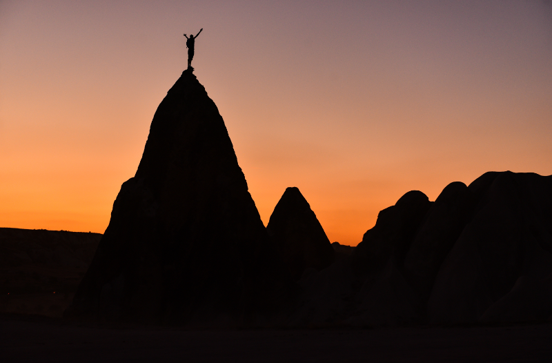 Person Standing On A Mountain Peak